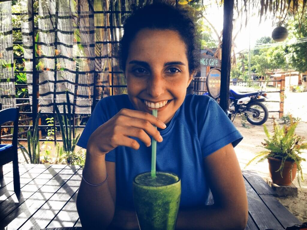 Drinking green juice in paradise